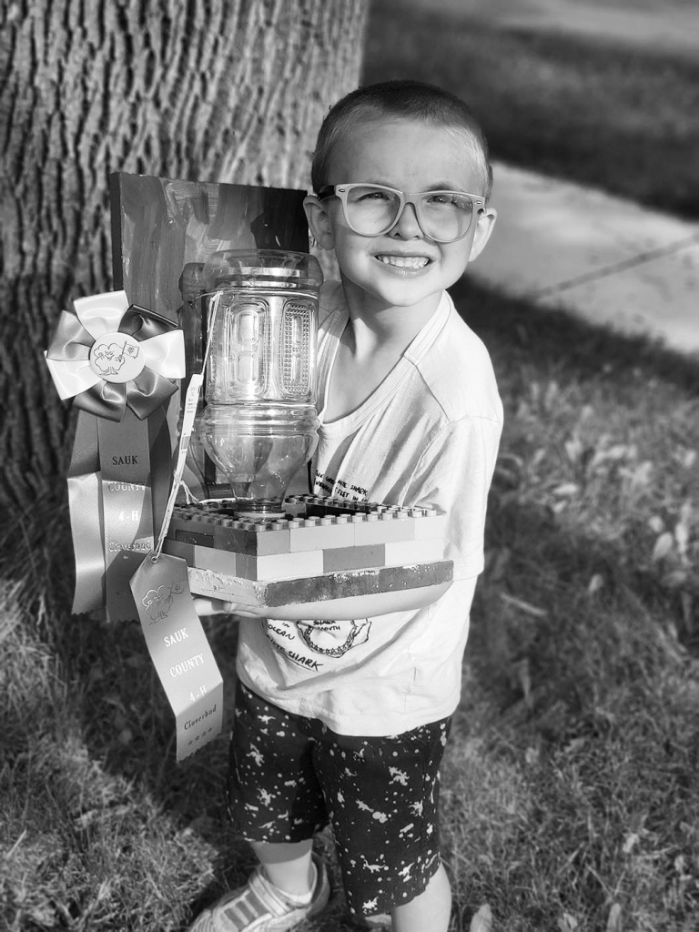 Sauk Prairie Earthlings 4-H member Brayden Wallace shows his cloverbud entry at the Sauk County Fair. Members were so excited to be back at the fair...