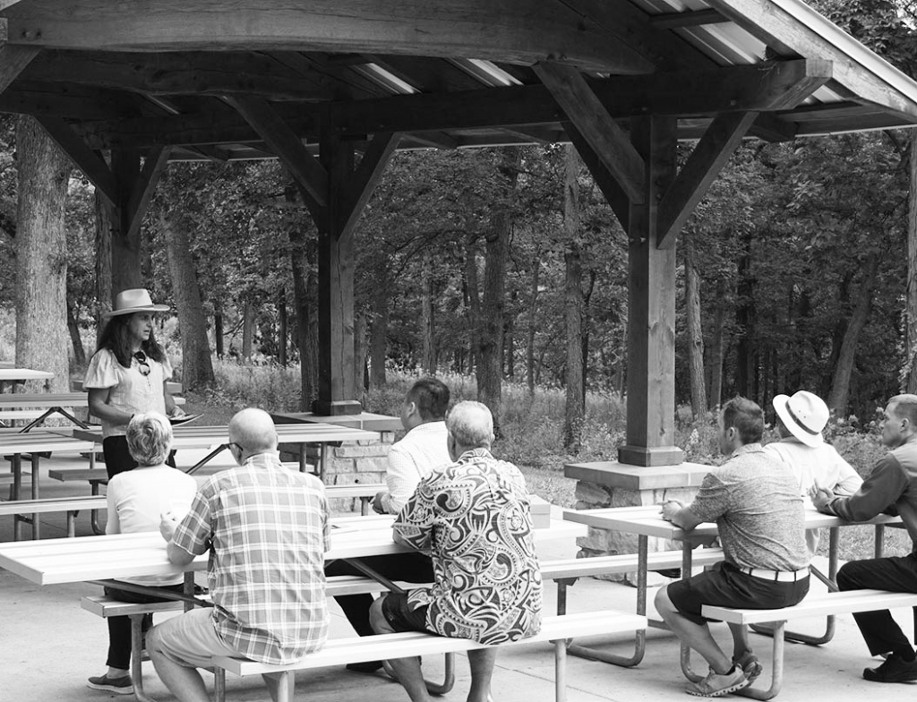 Mary Monroe Brown, Director of the new state Office of Outdoor Recreation, speaks with Cross Plains Village and other local leaders at Festge County...
