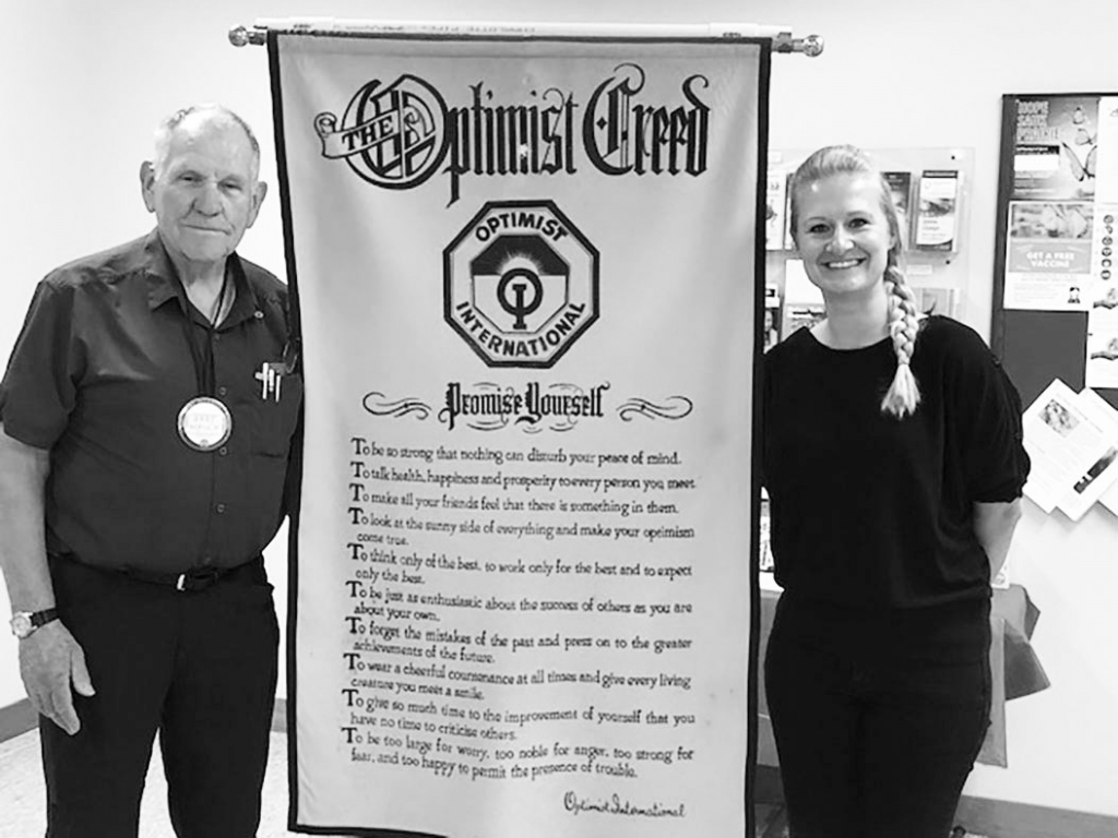 Sauk Prairie Optimist Club President Bart Mauch, left, and River Arts Inc. Executive Director Lindsey Giese, right, smile next to the Optimist...